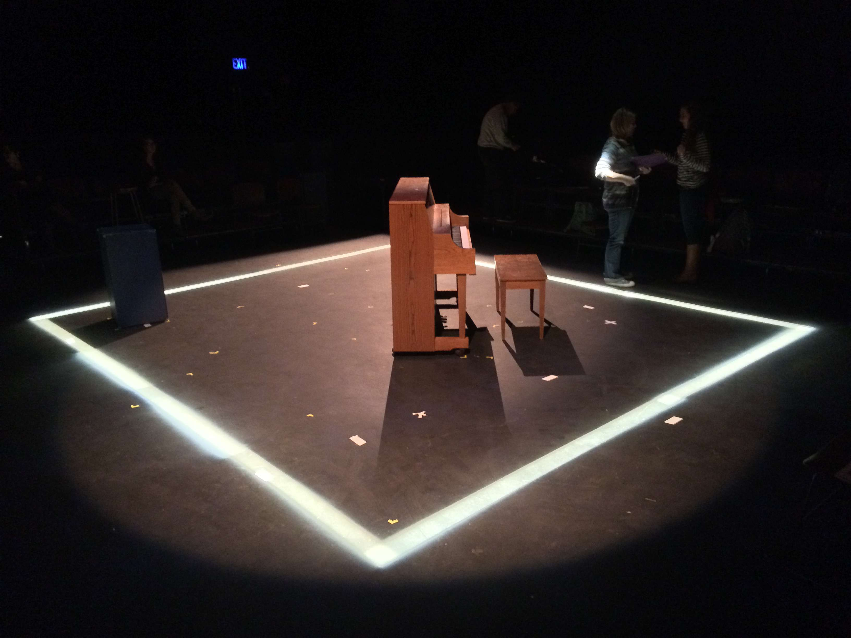 A scene from the show, featuring a distinct lighting design
