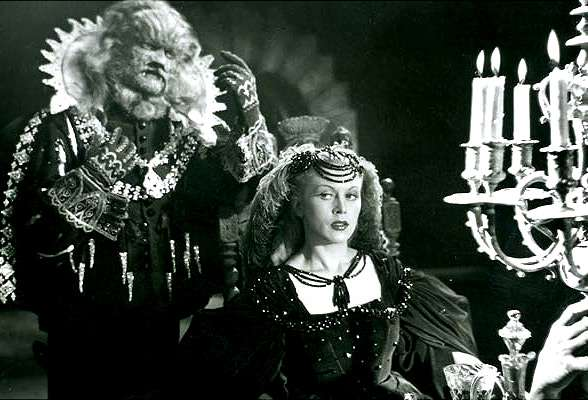 A still image from Cocteau's La Belle et la Bête was made in 1946, starring Jean Marais as the Beast and Josette Day as the Beaut.
